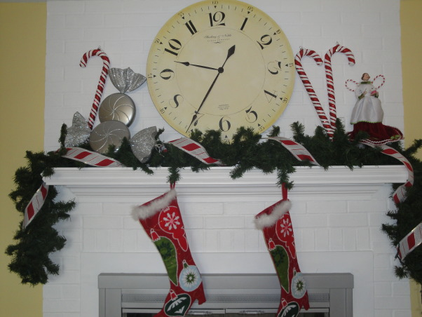 Red, white and peppermint Christmas! , My living room and dinning room are all ready for Christmas.  I decked everything out in red and white.  , This is the fireplace with garland, stockings, and decorations.    , Holidays Design