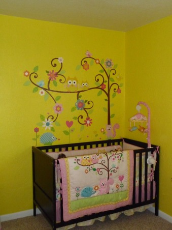 Dena Happi Tree Nursery, Here is our nursery for our baby girl who is due to arrive January 2, 2013. We wanted a fun space with lots of bright colors, but spacious and modern as well to go with the rest of our house. Please let us know what you think. We are so excited for her arrival as this is our first child. Thanks for looking!, Her crib and wall decals above  , Nurseries Design