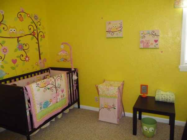 Dena Happi Tree Nursery, Here is our nursery for our baby girl who is due to arrive January 2, 2013. We wanted a fun space with lots of bright colors, but spacious and modern as well to go with the rest of our house. Please let us know what you think. We are so excited for her arrival as this is our first child. Thanks for looking!, Back wall as you enter her room.    , Nurseries Design