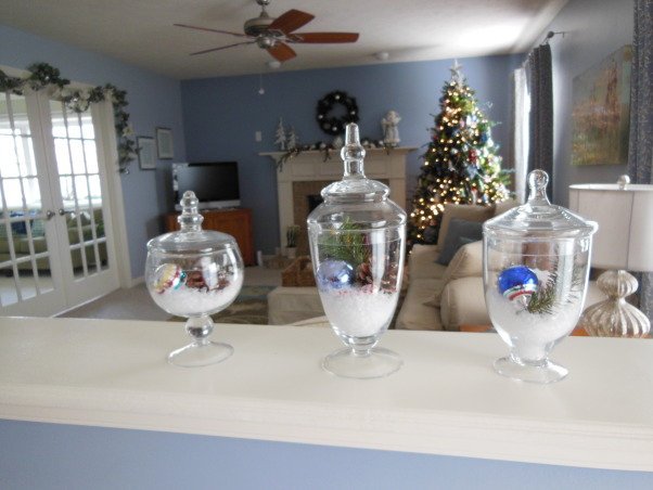 Cottage Style Christmas, We love  our bright cottage style kitchen and family room. I think using silver and white to decorate for christmas gives a festive look without using the traditional christmas colors. (The blue walls are not as bright blue as they show up on pictures), Apothacary jars filled with faux snow, vintage christmas ornaments and pine         , Holidays Design