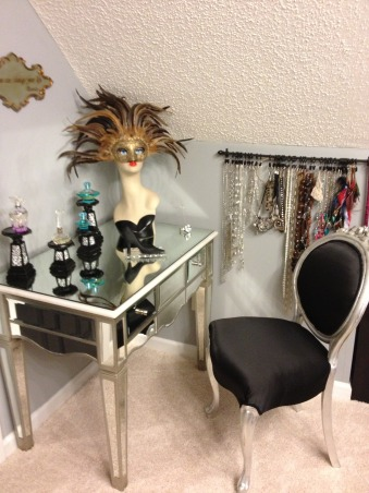 Stiletto House, Bonus Room turned Accessory Closet, Vanity with mannequin mask display , Closets Design