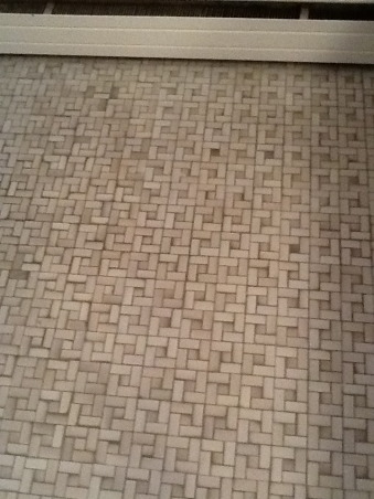 """Grey and Pink, Description: We have an L- shaped bathroom which we want to freshen up.We can't afford to replace tile or fixtures, basically want to paint,get new lighting,wall decor etc.There is grey tile from the floor to 55"""" up the wall.There is also a matching grey tile counter that is 90"""" long and has three drawers running horizontally and three drawers vertically with two sliding doors with shelving underneath.These are stained in a dark finish. I believe the wood is pine. There is also one window facing North which has the same dark stain as the drawers.This tile counter houses our pink sink.Above the sink is a large mirror which is 46"""" long by 30"""" tall. There is grey tile which borders the bottom edge of this mirror, so think we have to keep the mirror... But possibly build a frame around to update it? Our toilet is pink.There is also a small walk in shower with glass door.We have two hanging lights above sink which we want to replace.Our home is 55 years old and decorated pretty traditionally.I am at a loss as to how to update. My husband refuses to wallpaper this room again. I want to brighten it up, but need suggestions for a paint color.Also quite a bit of empty wall space which will need something on it.Also any ideas for new lighting? Should wood be painted ( drawers,cabinets, window?) Any ideas, suggestions will be greatly appreciated.Thank you., grey tile flooring , Bathrooms Design"""