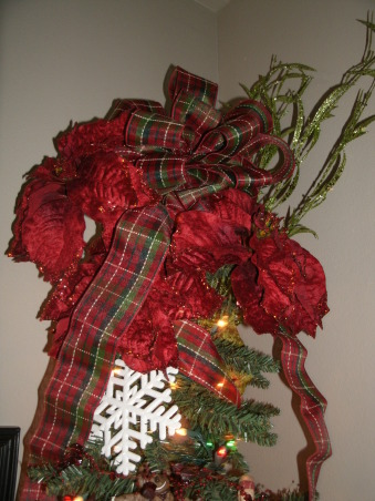 Christmas Splendor 2012 Part I., Here is a look at some of my 2012 Christmas decorations. Christmas is absolute favorite season! I have pictures of indoor and outdoor decor. There is lots to see and will be more pictures added as Christmas draws closer. I love to use old things in new ways so a lot of the decorations I use are from the past, just re-purposed in a new way. Enjoy! Merry Christmas!!!, Top of small tree, adorned with poinsettias and a large red and green plaid bow.   , Holidays Design