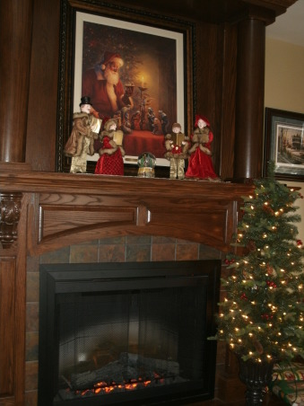 "Christmas Splendor 2012 Part I., Here is a look at some of my 2012 Christmas decorations. Christmas is absolute favorite season! I have pictures of indoor and outdoor decor. There is lots to see and will be more pictures added as Christmas draws closer. I love to use old things in new ways so a lot of the decorations I use are from the past, just re-purposed in a new way. Enjoy! Merry Christmas!!!, The fireplace with victorian carolers on the mantle along with our ""I do Believe"" picture of Old Saint Nick holding the Baby Jesus figurine from the manger scene. Absolutely gorgeous!   , Holidays Design"