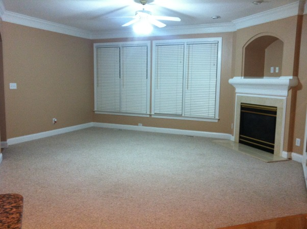 Odd shaped living room, Tan walls white crown modling, white and marble fireplace. Can someone please tell me how to furnish this odd shaped living room colors ect. Thank you , Odd shaped living room. I need ideas and colors on how to furnish it , Living Rooms Design