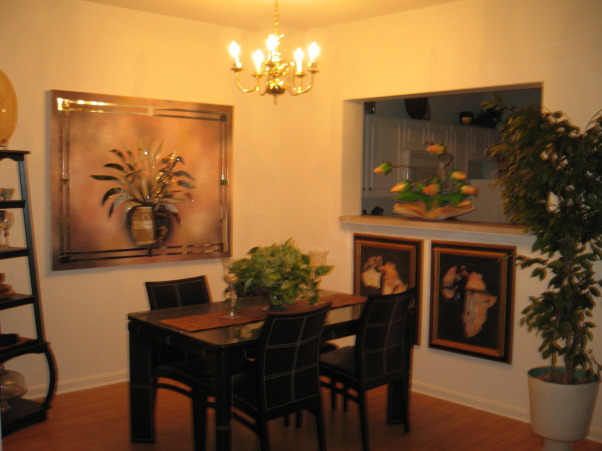 Apt Dining, Apartment living with a small dining space.  Fill it with art work, Art work gives the room a warm feeling on a daily basis., Dining Rooms Design
