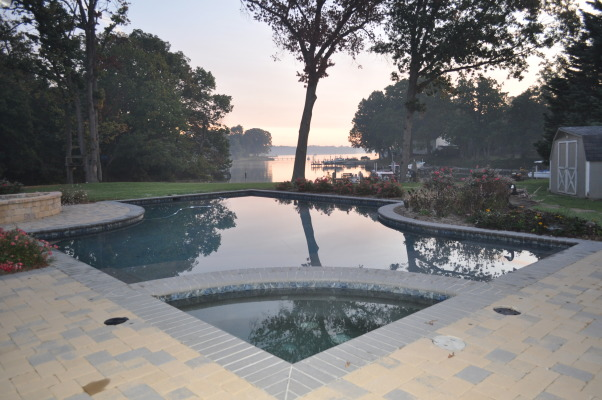 Resort at Home, This pool is situated overlooking the Wye River in Maryland.  Pool features a sun deck with an outdoor kitchen just steps away.  , Pool with corner hot tub overlooking the river. , Pools Design