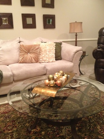 In My Zone Simple Elegance, Adding lights with cream, gold, and green accents this living and dinning areas were transform for the holidays., Living room sofa & table, change the pillows and add ornaments as a center piece low cost, high impact.  , Holidays Design