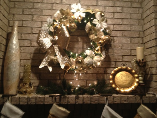 In My Zone Simple Elegance, Adding lights with cream, gold, and green accents this living and dinning areas were transform for the holidays., Wreath and Evergreens.  , Holidays Design