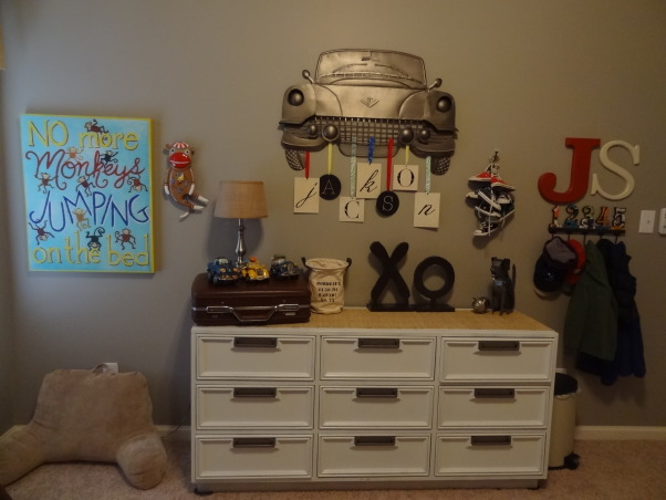 "Thrifty Eclectic Vintage Boy's room, My 3 1/2 year old was very excited to move in to his ""big boy"" room.  I re-used some items from his nursery to save money.  I scored by finding his iron bed, school desk, wagon, and dresser at local thrift stores. The dresser was 70's brown with brass hardware so I repainted it for an updated look.  Pinterest was a great source of inspiration! Introducing to you: Jackson's thrifty eclectic vintage big boy room!, Dresser- found for $75 at a thrift store and repainted I used an old suitcase from the attic to add height.   , Boys' Rooms Design"