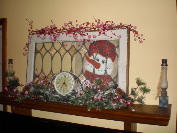 Christmas cheer, These are just few of my Christmas displays. My kids gave me the antique window for Christmas one year. The boxes full of little gifts are for the grandkids. I wrap each one, they love to open gifts, they are just one dollar items. A tradition my mom did. Thank goodness for the Dollar Tree and The Mighty Dollar.  I was so tickle when I found the book of The Littlest Snowman, it works well with these little fellows., I painted the snowman behind the glass., Holidays Design