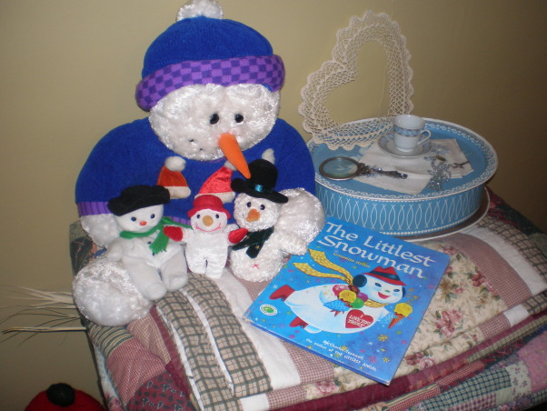 Christmas cheer, These are just few of my Christmas displays. My kids gave me the antique window for Christmas one year. The boxes full of little gifts are for the grandkids. I wrap each one, they love to open gifts, they are just one dollar items. A tradition my mom did. Thank goodness for the Dollar Tree and The Mighty Dollar.  I was so tickle when I found the book of The Littlest Snowman, it works well with these little fellows., I just love all my snowmen, and the grandkids do too.......thanks for dropping by...., Holidays Design