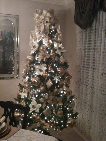 In My Zone Simple Elegance, Adding lights with cream, gold, and green accents this living and dinning areas were transform for the holidays., Holidays Design