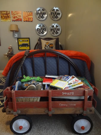 "Thrifty Eclectic Vintage Boy's room, My 3 1/2 year old was very excited to move in to his ""big boy"" room.  I re-used some items from his nursery to save money.  I scored by finding his iron bed, school desk, wagon, and dresser at local thrift stores. The dresser was 70's brown with brass hardware so I repainted it for an updated look.  Pinterest was a great source of inspiration! Introducing to you: Jackson's thrifty eclectic vintage big boy room!, An old wagon for $20 makes a great place to store shoes and books.   , Boys' Rooms Design"