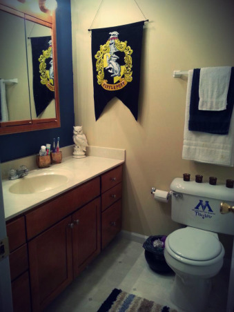 Harry Potter Bathroom, As many i grew up with harry potter as did my husband, so as to that i wanted something different for my bathroom and decided on a Harry Potter theme. I also wanted something more adult looking as of the more kid looking rooms I've seen before, so i concentrated on the colors navy blue, gold and white with touches of black and yellow to match the gold and went along from there. With Great items i found either thrift stores or beating my brains and even eyes searching the internet for things as well. This is the result and i hope you like the final result as i do., Overall look with candles and many harry potter decor as of contemporary decor as well., Bathrooms Design