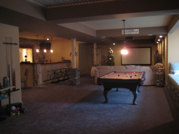 Warm and Cozy in a big space, We just recently finished our basement.  It was a very big and long space.  We wanted to create a warm, cabin like feeling and a space our soon to be teenage daughter could go to hang with friends., Main Area...Projection TV, Bar, Pool Table, Basements Design