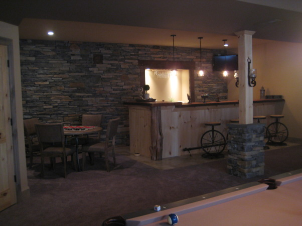 Warm and Cozy in a big space, We just recently finished our basement.  It was a very big and long space.  We wanted to create a warm, cabin like feeling and a space our soon to be teenage daughter could go to hang with friends., We built our own bar to fit the space!, Basements Design