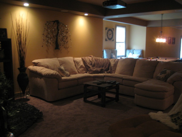 Warm and Cozy in a big space, We just recently finished our basement.  It was a very big and long space.  We wanted to create a warm, cabin like feeling and a space our soon to be teenage daughter could go to hang with friends., Seating area, Basements Design