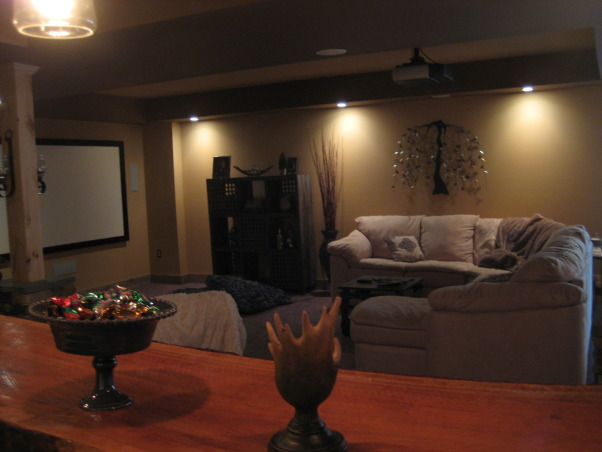 Warm and Cozy in a big space, We just recently finished our basement.  It was a very big and long space.  We wanted to create a warm, cabin like feeling and a space our soon to be teenage daughter could go to hang with friends., Seating area from behind the bar, Basements Design
