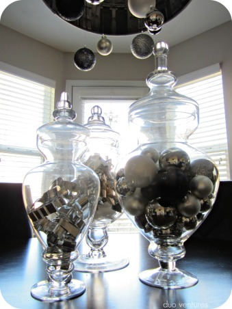 Neutral & Modern Holiday Decor, We like to keep our holiday decor color schemes & themes neutral.  We are relatively new homeowners, so we don't have a ton of decorations yet, but each year we add to our collection...hope you like it!  :), Apothecary jars are filled with ornaments, metal cookie cutters, & bows.  duoventures.blogspot.com    , Holidays Design