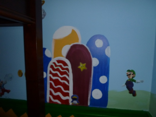 Super Mario Bros. World, I created a Super Mario Bros World for my 7 year old son. We used a loft bed with a desk underneath to try to ultilize his space and give him room to actually play in his room. I free handed the background and used removable wall decals for the mario characters. , Boys' Rooms Design