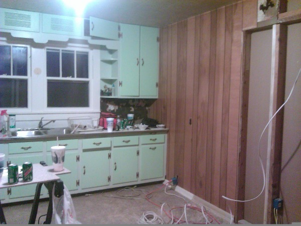 "My kitchen needs some major help, My kitchen is 11""6' across and about 11'8"" long  the counters are only 2 feet deep so it is all going to have to go....he entire house is only 900 SQ feet or so but the space just doesn't seem like it is going to be easy to make work? L shape maybe? I took pictures with hope that some one on here may have a great idea ...but at this moment this is the kitchen from hell ...keeping in mind this is a farm house I am trying to keep it simple..lol by complicating everything, This is view to the right of the sink the first door is going to be closed off we actually moved the door to give us a bit more wall space ...but now that we are really looking at we just don't know how to plan it without it being over kill for such a small house really ....ug, Kitchens Design"