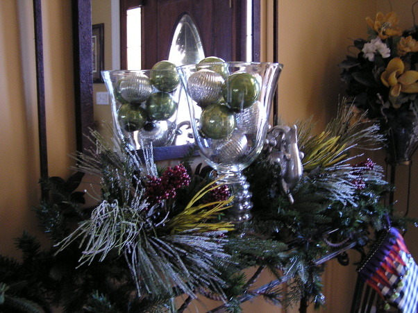 Double Take - Foyer, Holiday dressing on the entry table with a great reflective shot of the glass bowl and mercury glass balls., Are you seeing double?  NO!  Just an interesting shot of the glass vase with mercury glass Christmas balls in front of the foyer mirror., Holidays Design