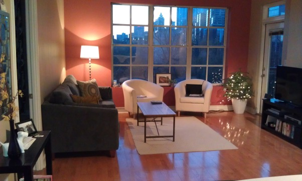 Living Room without personality! Need your help., I recently moved to a new state and completely refurnishing my new apt. The living room is in need of some life. I love the items I have so far (aside from the too-small rug), but need specific ideas for decor. Fire away with your suggestions! Please let me know what you like/don't like, sites you go to for ideas, etc. Thanks for your feedback!, I recently moved to a new state and getting all new home items. The living room needs help! The main wall is taupe and the accent wall is a rose color (not my choice, I am renting). The couch is gunmetal and chairs are off-white. I need to add some life to this room, especially with something eye-catching above the couch. Any interesting ideas? Please be specific!   , Living Rooms Design