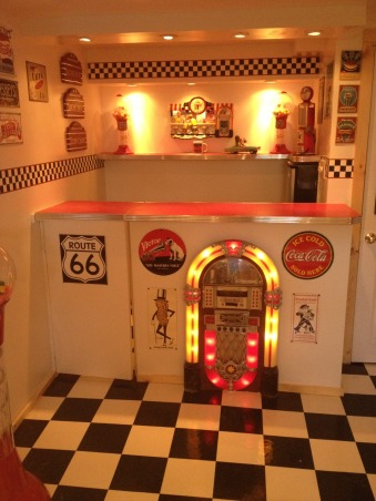 Retro 50's Diner/Bar, This was an unused basement space. I transformed it to a useable family room with a 50's look., A full view of the bar area., Basements Design