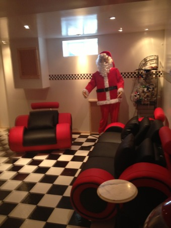 Retro 50's Diner/Bar, This was an unused basement space. I transformed it to a useable family room with a 50's look., Santa dancing in the basement retro diner., Basements Design
