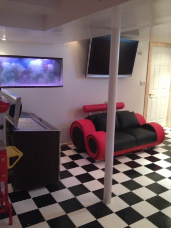 Retro 50's Diner/Bar, This was an unused basement space. I transformed it to a useable family room with a 50's look., This is a view from the bar. T.V. and fish tank., Basements Design