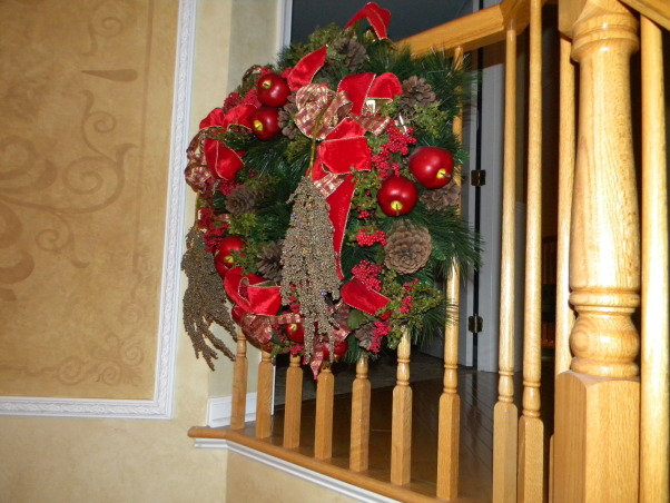 Christmas is Home for the Holidays!, Our Home decorated for Christmas!  It is a lot of work, but love it, love decorating, and truely love to stand back and take a deep breath, and enjoy every piece of Christmas.  It is my favorite time of the year!, A wreath hanging on the staircase in the Foyer.   , Holidays Design