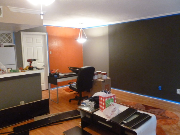 Orange and Gray Living Room, This is a rent apartment, so I can't make major changes. I would have change the ceiling lamp, but, oh well. The paint is a dark charcoal ( Behr DARK CAVERN), the other is orange (Behr KOI, but it was too bright so the helpful guys at Home Depot help me and they added more black so the color became a spice/terracota).  The coffee table is from OVERSTOCK, the carpet from HAYNEEDLE, table, chairs and floor lamp from IKEA, photo frames from WEST ELM, shelfs from CRATE & BARREL, orange print chair from TARGET, orange rectangular pillow from CHIASSO. , My original idea was to use three different shades of gray. But the medium gray was not quite what I expected. So in the end I decided to keep the charcoal, remove the other grays and add orange.   , Living Rooms Design