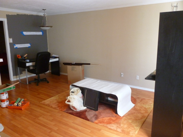 Orange and Gray Living Room, This is a rent apartment, so I can't make major changes. I would have change the ceiling lamp, but, oh well. The paint is a dark charcoal ( Behr DARK CAVERN), the other is orange (Behr KOI, but it was too bright so the helpful guys at Home Depot help me and they added more black so the color became a spice/terracota).  The coffee table is from OVERSTOCK, the carpet from HAYNEEDLE, table, chairs and floor lamp from IKEA, photo frames from WEST ELM, shelfs from CRATE & BARREL, orange print chair from TARGET, orange rectangular pillow from CHIASSO. , In case you want to know how it looked before.   , Living Rooms Design