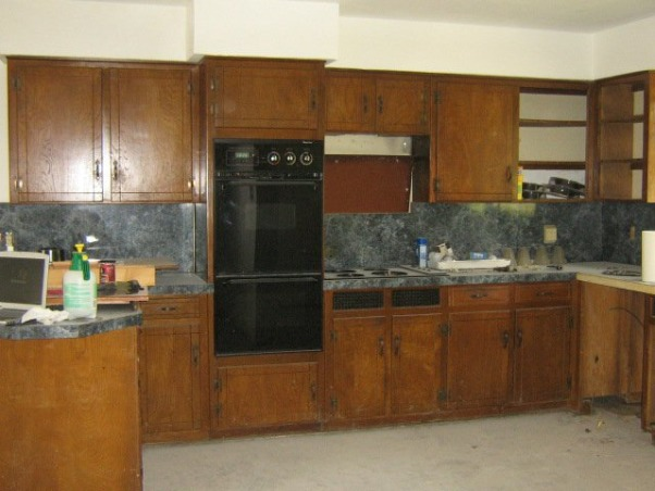 $3500 Kitchen Remodel!, Bought a country house that was in BAD shape!  Fixed it up on the cheap (~$3500 incl floor!).  CLEANED EVERYTHING, painted the existing wood cabinets, new appliances, cleaned & sealed the concrete floors--and now we love it!  , Old 70s cabinets were in great shape...just UGLY!  Had several friends doubting my vision.  lol          , Kitchens Design