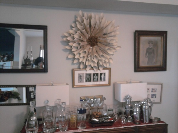 2012 Christmas, It's all about glitter this year.  I added glitter to the paper wreaths I made last year and made a glitter centerpiece for the foyer.  Instead of a star this year I constructed a tree topper out of various types of glitter branches., The other updated paper wreath hanging over the buffet in the dining room., Holidays Design