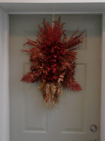 2012 Christmas, It's all about glitter this year.  I added glitter to the paper wreaths I made last year and made a glitter centerpiece for the foyer.  Instead of a star this year I constructed a tree topper out of various types of glitter branches., Made a avant garde swag out of left over glitter branches for my front door., Holidays Design