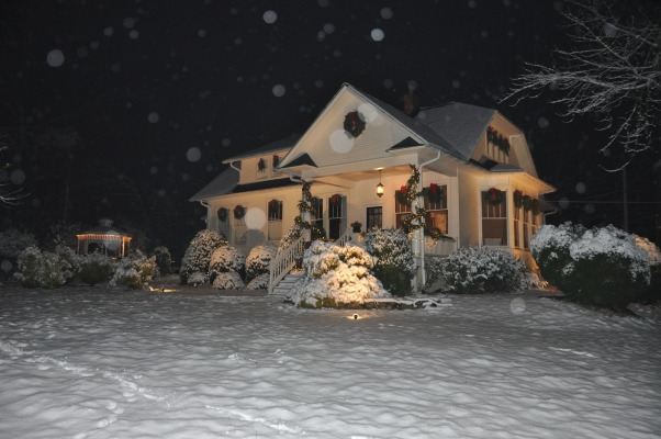 A White Christmas Bungalow Decorated for the Holidays, Exterior of home with homemade wreaths and Christmas decorations and the snow of Christmas Eve, It's a white Christmas         , Holidays Design