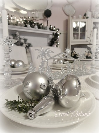 A White Christmas, This years theme was a White Christmas all on a tight budget! http://sweetmelanie.blogspot.com/, I had some leftover ornaments, so I used them along with some clippings from our evergreens.  Simple but beautiful...  , Holidays Design