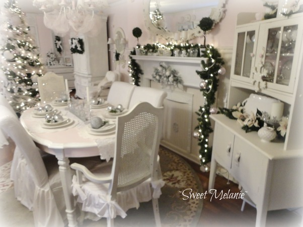 A White Christmas, This years theme was a White Christmas all on a tight budget! http://sweetmelanie.blogspot.com/, This past year we added an old fireplace mantle.  Perfect at decorating for any holiday.  I had previously had pink slipcovers and decided to make white ones.  They added the perfect touch!  , Holidays Design