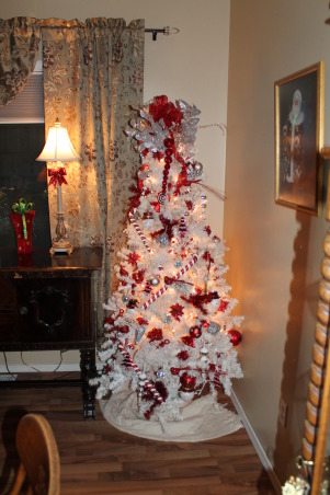 Loving Christmas, My new addition is this red and white tree. I have had the tree but repurposed it and I just love the way it turned out!, I repurposed my little faded white christmas tree and set it up in my dinning room and incorporated a red and white theme.  I just love it!! I might have to get another one to flank the other side of my buffet table!! :), Holidays Design