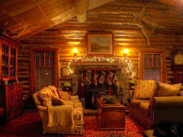 Christmas At The Cabin, The Living Room decorated for Christmas in our C1900 log cabin in Wyoming, A dear friend of mine ( and brilliant author, George Behe...author of many books on Titanic ) saw this photo and decided to brighten it up a bit....You can now see the 1830's step-back cupboard on the left and Brojan, my amazing service dog in the right hand corner! Thanks my friend! Most of the art in the cabin represents my love of western etchings and oils by Marie Dolph, Eric Sloane and Family portraits. Thanks so much for looking!, Living Rooms Design