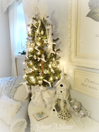 Our Master ready for Christmas, This space is our downstairs master.  I had fun decorating it in a romantic theme this year., Decorated in white and silver with strips of white fabric tied onto the branches.  Very simple, but beautiful!, Bedrooms Design