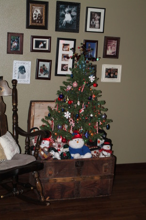 Loving Christmas, My new addition is this red and white tree. I have had the tree but repurposed it and I just love the way it turned out!, My yard sale tree with no stand. I decided to prop it up in an old trunk and fill it with my stuffed snow men. My kids are high schooler's and dont appreciate the fun little things that make christmas memorable so keeping this tree whimsical and playful keeps my memories of their childhood in mind., Holidays Design