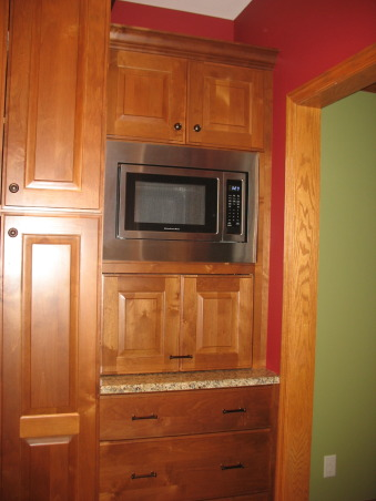 Out with the '90's Kitchen, We remodeled our Kitchen from the dated space from the 1990's.  , Appliance garage. , Kitchens Design