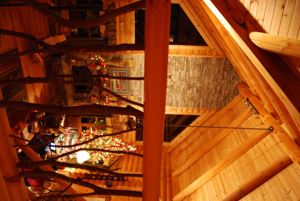 "Our Log Home Christmas 2012, It has been a few years since I have posted any pix of the interior decorations here at our log home deep in the secluded woods in the North Georgia Mountains. Thought I should get ""unlazy"" and post a few., View through loft mountain laurel railing to the great room and beamed cathedral ceiling            , Holidays Design"