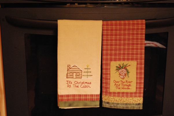 "Our Log Home Christmas 2012, It has been a few years since I have posted any pix of the interior decorations here at our log home deep in the secluded woods in the North Georgia Mountains. Thought I should get ""unlazy"" and post a few., I just love these two dishtowels.  They hang on the wall oven door in the kitchen.           , Holidays Design"
