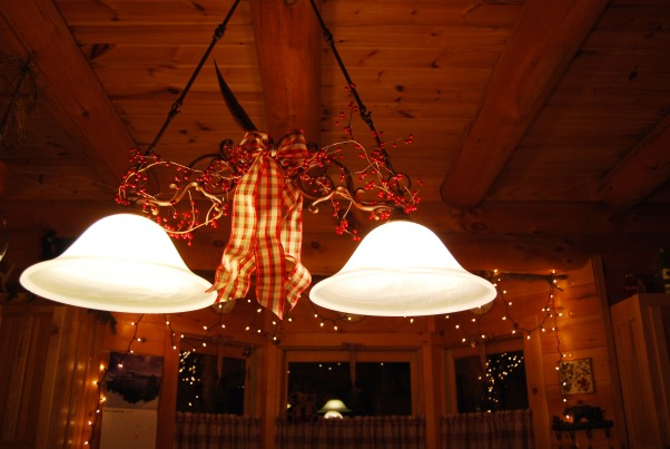 "Our Log Home Christmas 2012, It has been a few years since I have posted any pix of the interior decorations here at our log home deep in the secluded woods in the North Georgia Mountains. Thought I should get ""unlazy"" and post a few., Light fixture over the oven in the kitchen gets berries and a pretty plaid bow.           , Holidays Design"