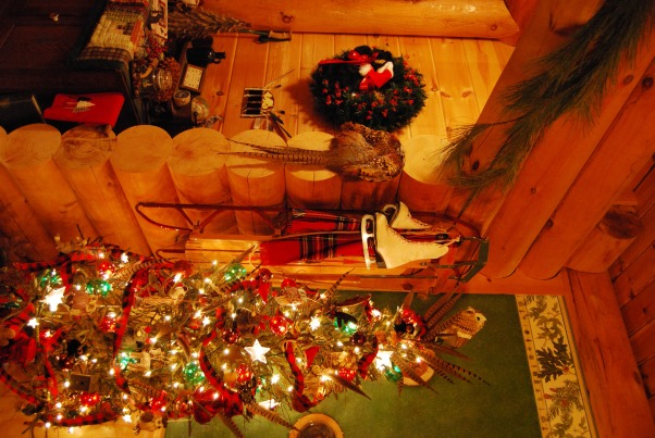 "Our Log Home Christmas 2012, It has been a few years since I have posted any pix of the interior decorations here at our log home deep in the secluded woods in the North Georgia Mountains. Thought I should get ""unlazy"" and post a few., Skinny rustic tree in the corner of the dining room, sled and ice skates (that hang there year round), and the wreath with little black bear as you enter the great room            , Holidays Design"