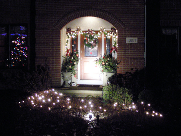 Symmetric Curb Appeal Winter Holidays, Changing entryway to reflect the wintry charm of the holiday season., A spotlight can create drama. , Home Exterior Design